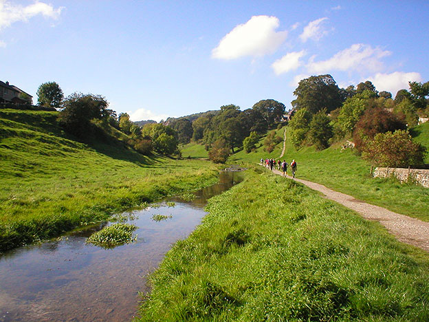 Walkers in Bradford Dale below Youlgrave