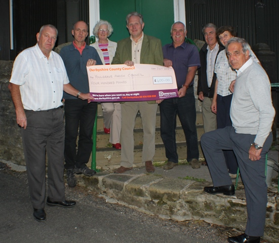 County Councillor Simon Spencer presents Council with a grant towards the website design costs